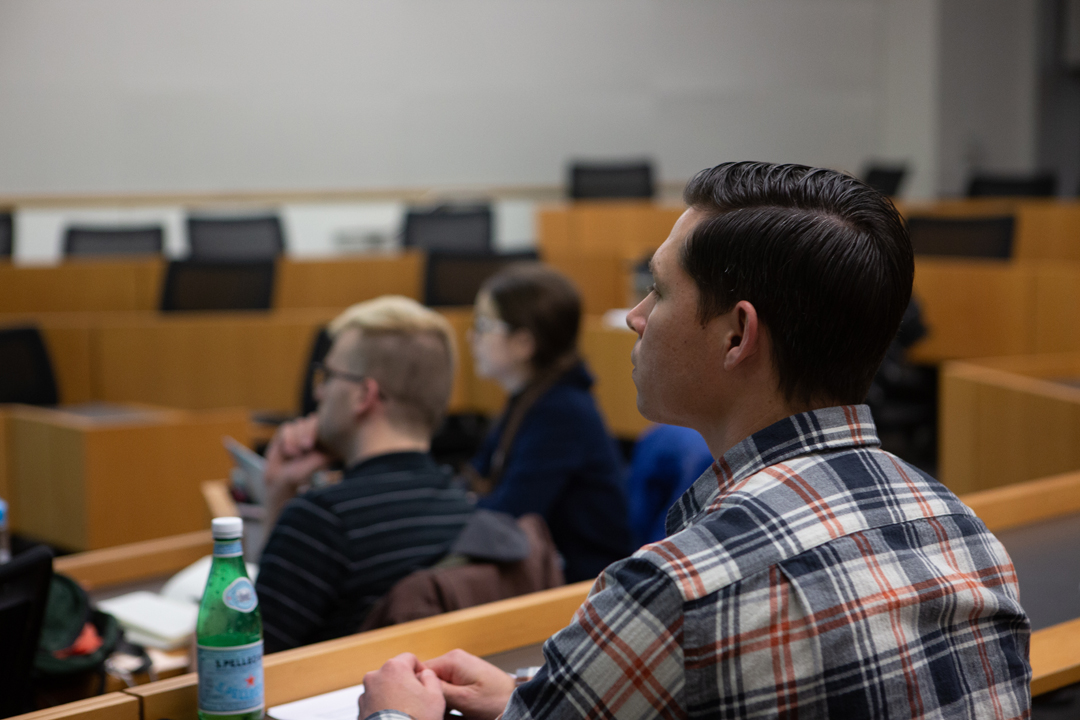 A student listening to an applied economics lecture