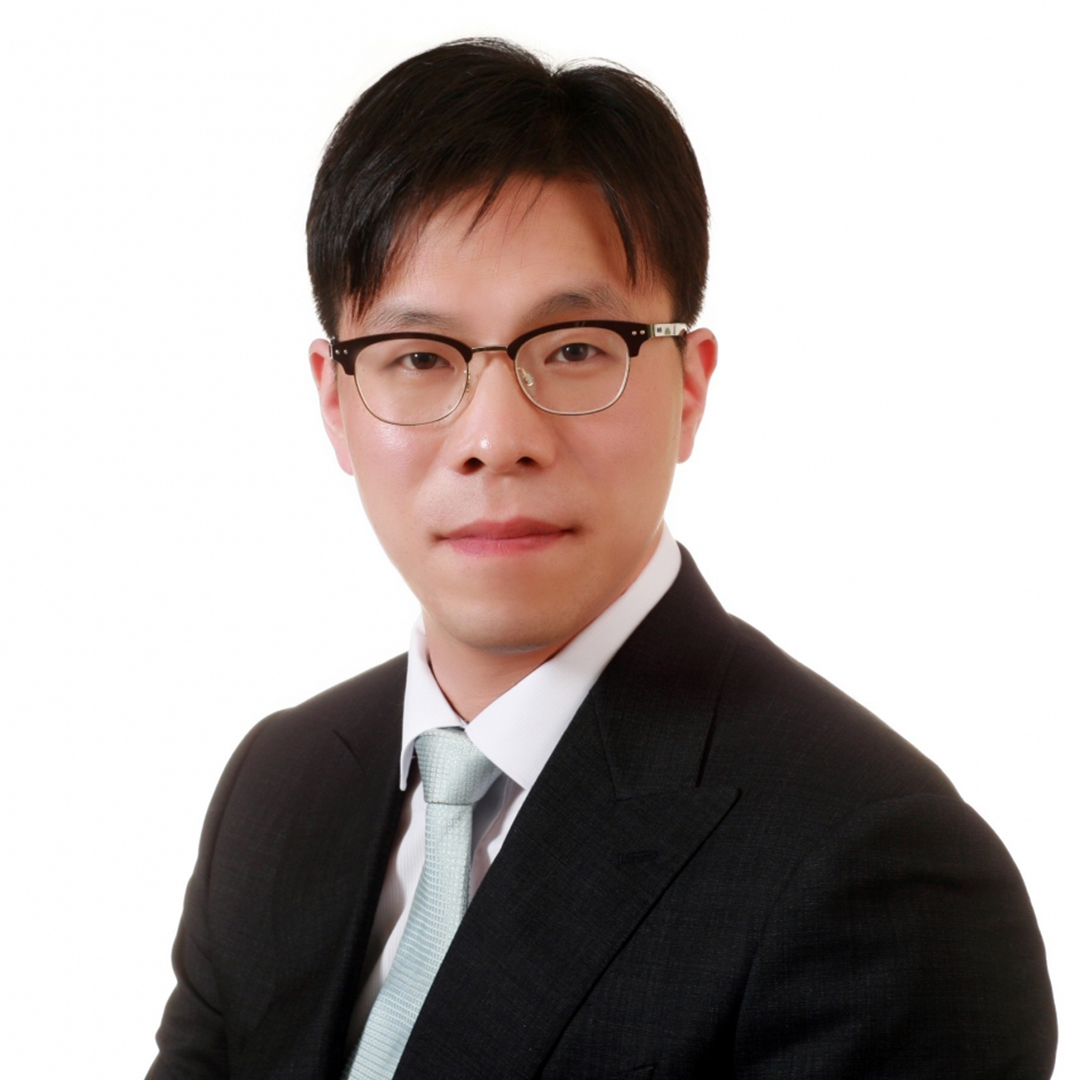 PhD Student, Jin Ho Kim, wearing a black suit with a mint tie in front of a white background